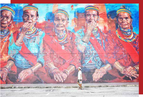 Artist completes giant mural featuring 5 Semban ring ladies